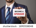 Small photo of Become a Sponsor. Investment, Business Concept. Businessman holding a card with a message text written on it