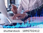 Small photo of Two traders man and woman researching historic data to predict stock market behavior using laptop. Internet trading concept. Forex and financial hologram chart. Forecasting and planning.