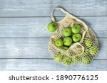 Green Apples In A String Bag On ...