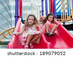 Two Girls On The Red Slide