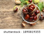 Horse Chestnuts On Wooden Table ...