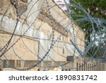 Concrete Fence With Barbed Wire