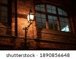 the dark street is lit by...   Shutterstock . vector #1890856648