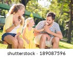 girl feeding her father with an ...   Shutterstock . vector #189087596