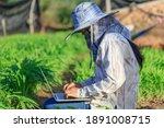 thai farmer is using a laptop...   Shutterstock . vector #1891008715