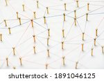 Small photo of abstract web line connection of color yarn from nail node to node on white background , networking concept
