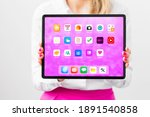 woman holding tablet with...