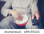 young man is sitting on a sofa... | Shutterstock . vector #189155222