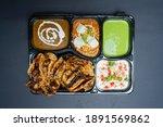 Chur Chur Naan Platter - A combo of Chur Chur naan with Paneer Butter Masala and Dal Makhani served with Mint chutney, Raita and onions