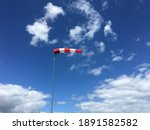 Red And White Striped Windsock...