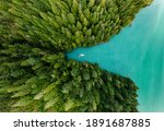 Boat Moored In A Cove With...