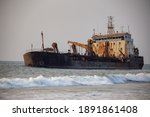 A Dredger At The Shores Of...