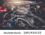 Powerful Vintage Classic Car Combustion Gas Carburettor Engine. Looking Under the Hood.  - stock photo