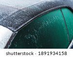 Modern Fabric Convertible Vehicle Roof Covered by Ice and Freezing Rain During Extreme Low Temperatures. Cabriolet Winter Driving Theme. - stock photo