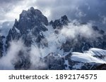 A picture of the Cadini di Misurina mountain range, with dramatic clouds, near Cortina d'Ampezzo, in the Italian Dolomites - stock photo