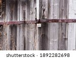 Padlock On Wooden Doors Of An...
