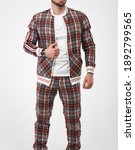 Man Wears Checkered Tracksuit....