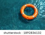 Orange Life Buoy Floating In...