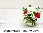 A Bouquet Of Fresh Flowers In...