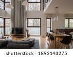 Small photo of Stylish and luxury two-floor apartment with living room, dining room and kitchen in one room with amazing big windows