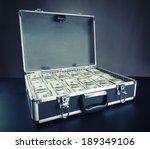 Case Full Of Money On Gray...