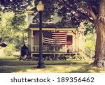 American Home With Us Flag For...