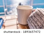 Woman Taking Coffee Break on the Cruise Ship Main Deck Chair During Clear Sky Sunny Weather. Sea Travels Theme. - stock photo