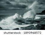 Wave Breaking On Rocky Shore...