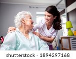 Small photo of Ladies having a friendly conversation, diligent nurse and senior resident patient, doctor patient concept