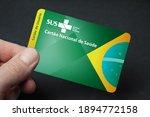 Small photo of Brazil - January 15, 2021: Brazilian Unified National Health System. National Health Card. (SUS - Sistema Unico de Saude. Cartao Nacional de Saude). Man's hand holding SUS card.