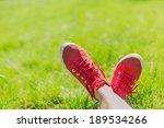 Feet In Sneakers In Green Gras...