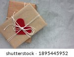 Gift Box With Heart On Gray...