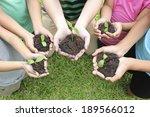 hands holding sapling in soil... | Shutterstock . vector #189566012