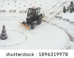 Tractor Excavator Removes Snow...