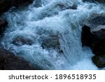 Fast moving water over rocks in ...