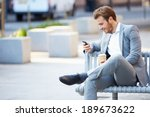Businessman on park bench with...