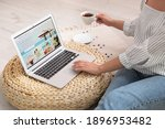 Small photo of Woman booking tickets online indoors, closeup. Travel agency concept