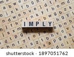 Small photo of Imply word concept on cubes