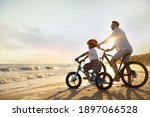 Happy Father With Son Riding...