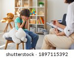 Small photo of Children need help. Bullied little schoolgirl crying in psychologist's office unable to control emotions, sharing problems and traumas. Professional psychotherapist talking to distressed bully victim