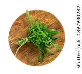 Small photo of Arugula bunch on wooden plate isolated. Fresh arugula, ruccola leaves, rucola, eruca or garden roquette salad top view