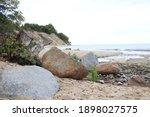 Large Stones On A Sandy Beach...