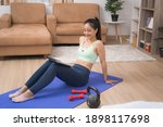 asian woman viewing the tablet...   Shutterstock . vector #1898117698