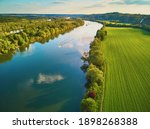 Scenic aerial view of the Seine river and green fields in French countryside. Val d