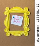 """Small photo of Vintage yellow photo frame or mirror frame from the Friends series. Framing the phrase I """"ll be there for you. Cork background."""