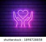 hands holding heart neon sign.... | Shutterstock .eps vector #1898728858