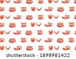 Set Of Dentures On A White...