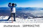 Happy Skier Man Holding Pair Of ...