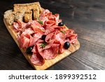 Salami On Wooden Board With...