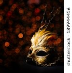 Golden Venetian Mask Over Blac...